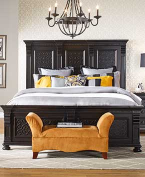 Fancy dark brown bedframe with elegant sheets