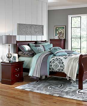 cherry wood dressers and bedframe