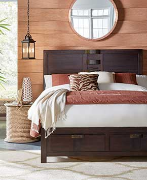 Queen sized bed with dark wood bedframe and hanging lights