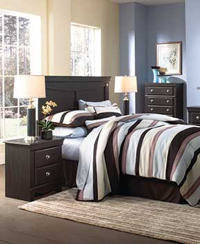 modern bedroom with dark wood dressers and bedframe