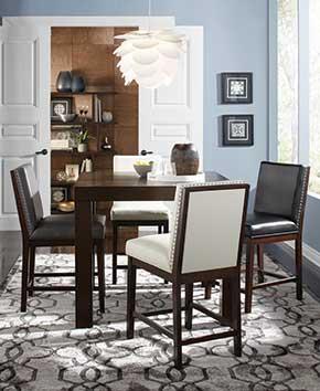 wooden dining room table with leather padded chairs