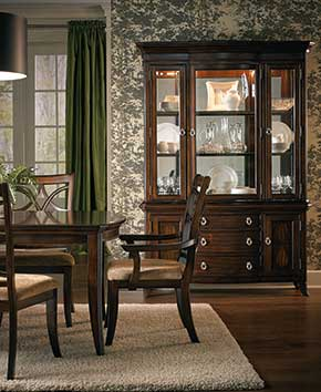 brown cabinet with matching dining table and chairs