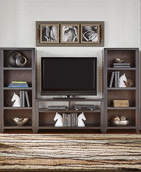 brown TV stand with bookshelves