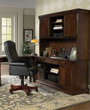 home office with black leather rolling chair and brown desk