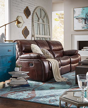 living room with blue dresser and brown leather reclining sofa