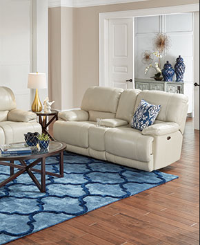 living room with white leather reclining loveseat