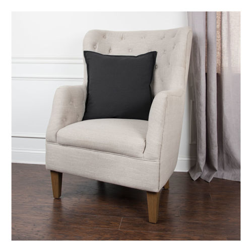 Picture of Black Cotton Throw Pillow on Beige Chair
