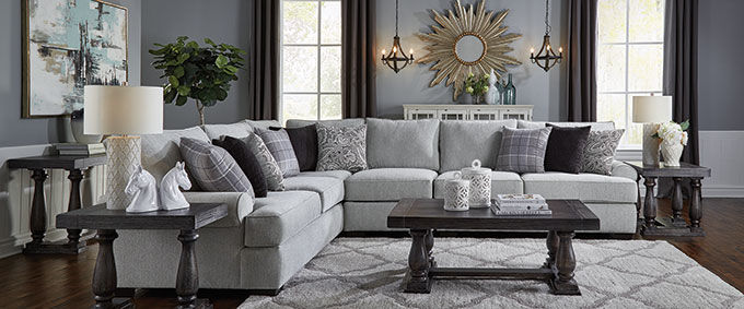Grey sectional sofa with decorative pillows